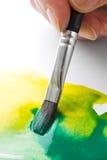 De kunstenaars schilderen borstel en verf Stock Afbeeldingen