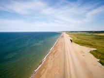 De kustlijn van Norfolk, zonnige dag bij het strand Stock Fotografie