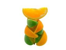 De kwabjes van sinaasappelen en appelen royalty-vrije stock foto