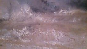 De kwaststreken drukken oceaangolf van sterke wind uit stock foto's