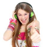 De l'adolescence avec des écouteurs Image libre de droits