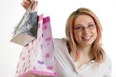 De l'adolescence avec des sacs à provisions Photo stock
