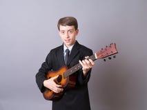 De l'adolescence avec la guitare Image libre de droits