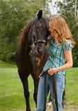 De l'adolescence avec le cheval Photos stock