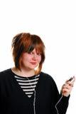 De l'adolescence avec le joueur MP3 Image stock