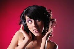 De l'adolescence dans des écouteurs Photographie stock