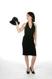 De l'adolescence dans la robe noire avec le premier chapeau noir Photo stock