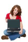De l'adolescence heureux avec l'ordinateur portatif Image stock