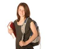 De l'adolescence portant un livre et un sac à dos Image libre de droits