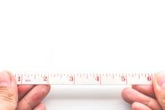 De la medida cinta métrica a mano - Fotografía de archivo libre de regalías