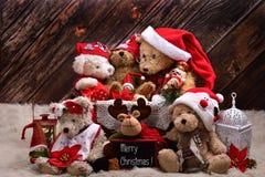 De la Navidad de peluche del oso todavía de la familia vida con deseos en inglés Fotos de archivo libres de regalías