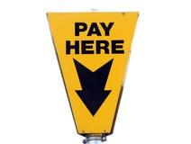 De la paga letrero amarillo aquí Foto de archivo libre de regalías