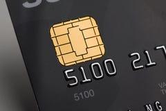 De la tarjeta de crédito con la viruta del oro Fotos de archivo libres de regalías