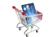 De la tarjeta de crédito en una carretilla de las compras Fotografía de archivo libre de regalías
