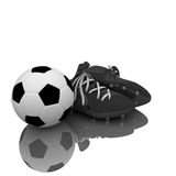 De laarzen en de bal van het voetbal Stock Afbeelding