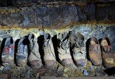 De laarzen van de oude mijnwerker Stock Afbeeldingen