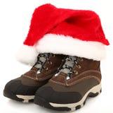 De Laarzen van de sneeuw met de Hoed van de Kerstman stock afbeeldingen