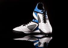 De laarzen van de voetbal. De laarzen van het voetbal. Royalty-vrije Stock Afbeeldingen