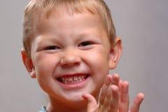 De lachende jongen Stock Foto's