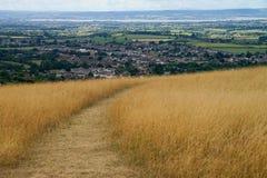 De landelijke manier Stroud van landschapscotswold bij achtergrond Royalty-vrije Stock Afbeelding