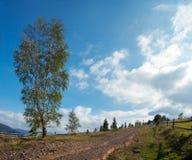 De landweg van de berg stock afbeeldingen