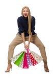 De lange vrouw met plastic die zakken op wit wordt geïsoleerd Royalty-vrije Stock Foto