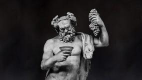 De Langzame Motie van het Dionysusbeeldhouwwerk op een Zwarte Achtergrond