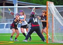 De las muchachas del equipo universitario del lacrosse juego de Fianls semi Imagenes de archivo