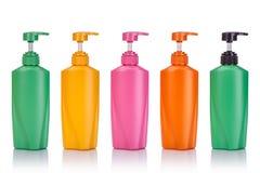 De lege groene, gele, roze en oranje plastic pompfles gebruikte FO Stock Foto
