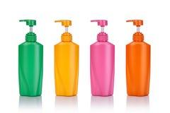 De lege groene, gele, roze en oranje plastic pompfles gebruikte FO Royalty-vrije Stock Afbeelding