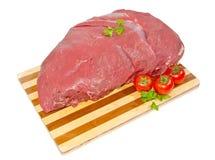De lendelapjes van het kalfsvlees op een scherpe raad Stock Fotografie