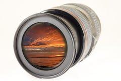 De lens van de camerafoto over witte achtergrond Stock Afbeelding