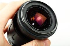 De lens van de de holdingscamera van de hand Royalty-vrije Stock Afbeelding