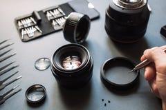 De lensreparatie van de fotocamera en onderhoudsreeks Stock Foto's