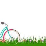 De lenteachtergrond met een vrouwenfiets op gras met bloemen Royalty-vrije Stock Foto