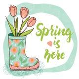 De lentekaart met regenlaars en tulpen Stock Foto