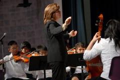 De leraar leidt orchesta Royalty-vrije Stock Afbeeldingen