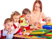 De leraar van de kleuterschool met kinderen. Royalty-vrije Stock Foto