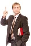 De leraar van de school met boeken heft naar omhoog vinger op Royalty-vrije Stock Foto's