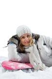 De leugen van de vrouw snowboarder aan boord Stock Foto