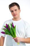 De leuke jonge mensen geven de bloemen Royalty-vrije Stock Afbeelding