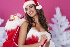 De leuke vrouwelijke Kerstman stock afbeeldingen