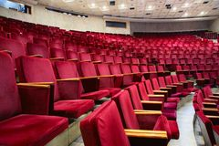 De leunstoel van het theater stock afbeeldingen