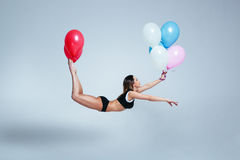 De levitatie van de vrouwenballon Royalty-vrije Stock Foto's
