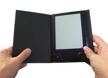 De lezer van EBook in handen Stock Afbeeldingen