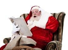 De lezingsboek van de Kerstman royalty-vrije stock foto's