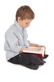 De lezingsboek van het kind stock afbeeldingen