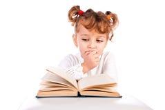 De lezingsboek van het kind Stock Foto's