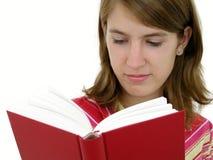 De lezingsboek van het meisje stock fotografie