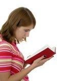 De lezingsboek van het meisje stock foto's